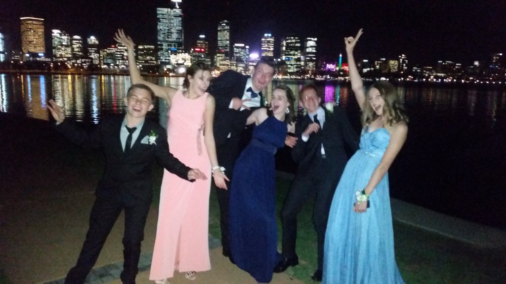 Limo Hire Perth helped these school ball guests to celebrate with Limousines Unlimited at South Perth.