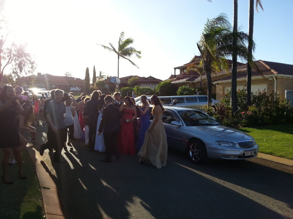 Wedding Car Hire Perth WA helping these ladis and lads celebrate their school ball hire