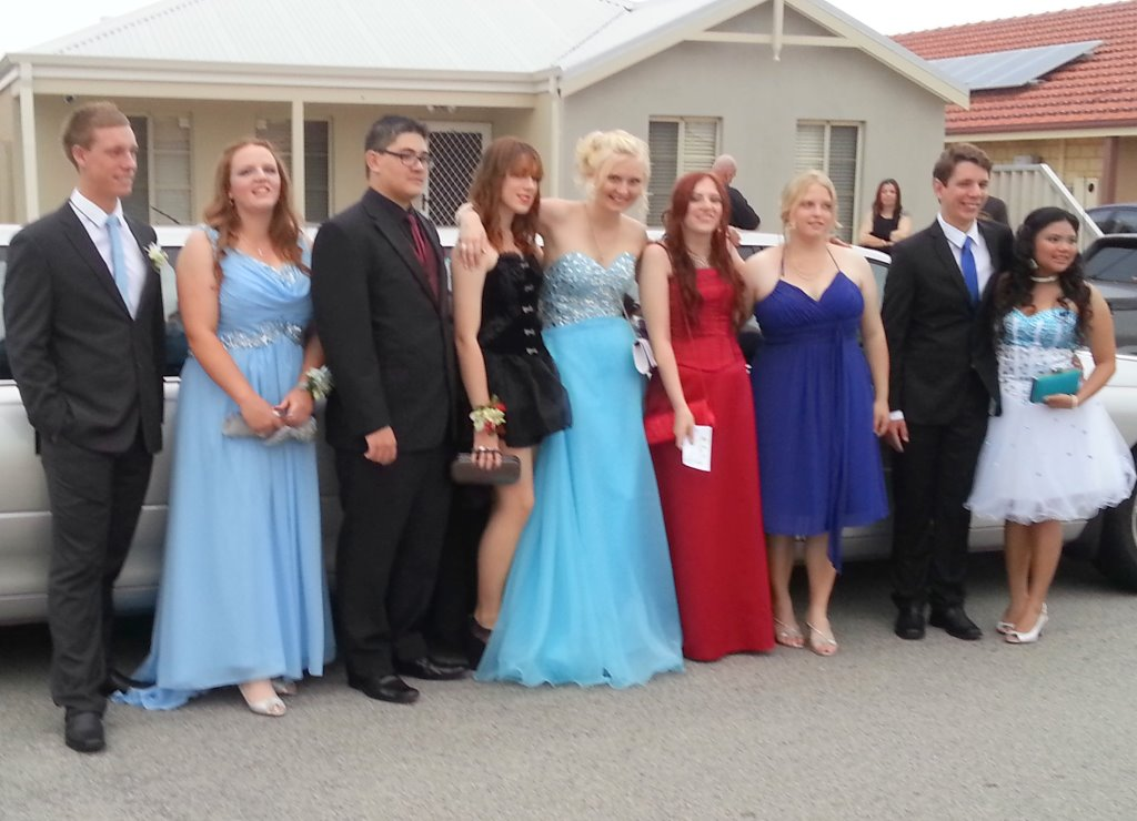 School ball night limo group ready for a great night out