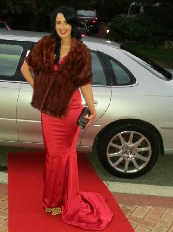 Wedding Limousine hire Perth with Lovely lady in red on red carpet